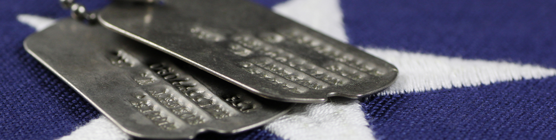 A pair of dog tags on the American flag